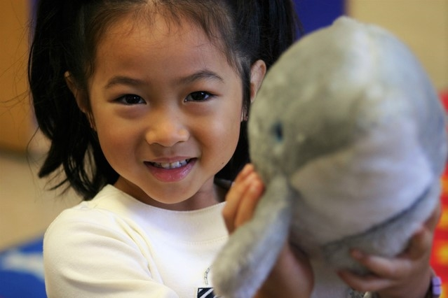 Engage children in conversation about things that interest them - like dolphins!
